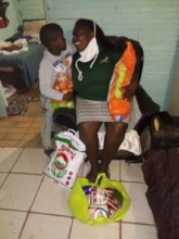 A happy mom and her son with their food parcel.