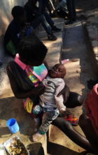 Mum and baby supported by Kimbilio outreach team