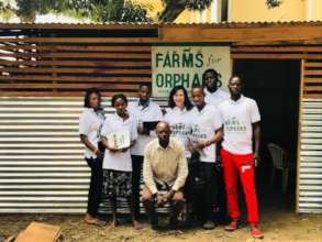 Youth farmers at the orphanage palm weevil farm
