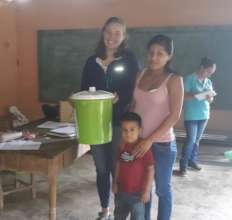 Volunteer Lizzie Distributing Water Filters
