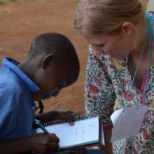 ConnecTeach Program Director with Iganga student
