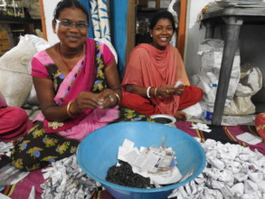 Village women prepare seed packs for distribution