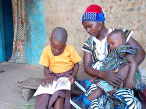 Kitindo reading to her Mother (Lipeenba) at home