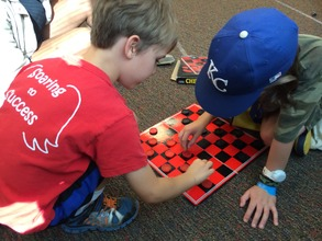 Teaching a camper to play checkers