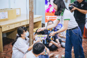 Children at Ceporer Hocmon receive gifts from MSD