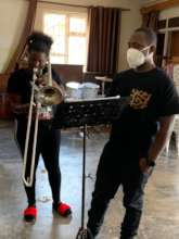 Babirye in Trombone lesson at KMS