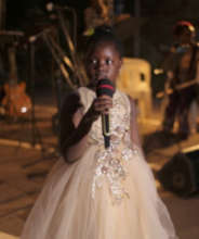 Leyna singing at the KMS Garden Party in Sep