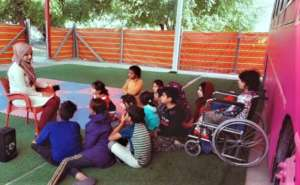 A girl with  wheelchair joins the Hope Bus classes