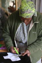 Karunga woman producing sanitary pad shield