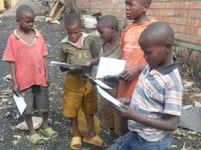 Young people reading the Marembo Journal