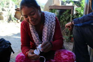 Village woman receiving solar training