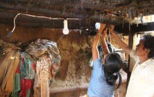 Installing solar light inside a village home