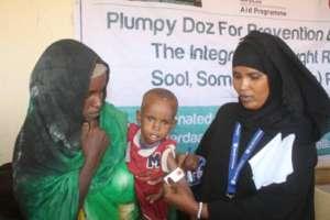 Malnourished Child Receives Nutripacket