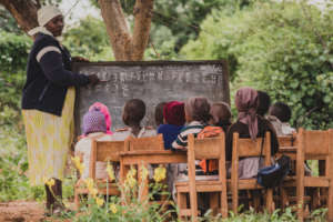 class in session for ECD learners under a tree
