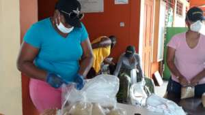 Packing food parcels to distribute to needy