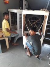 Ramesh and Nissar repairing our water cooler.