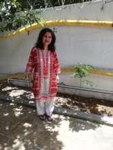 Ambreen with her moringa tree