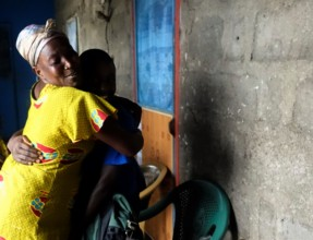 Kwame* and his mother embrace upon his arrival