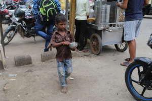 Street child begging on roads