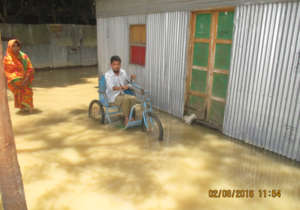 Person with Disabilities are in  Flood water.