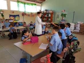 Dr. Idalia Providing Dental Education