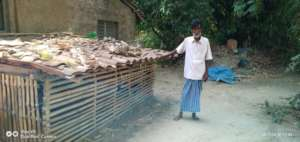 Ummera's father outside their hut