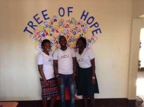 HCU coordinators with intern/student art project