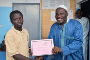 Horticulture teacher handing over a certificate