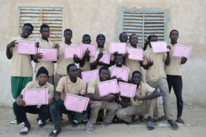 Group portrait with certificates