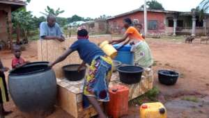 Residents store water in drums