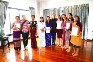 Students pose with their Graduation Certificates