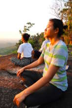 Students meditate during visit to Forest Temple