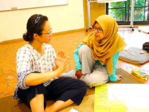 Annisa conversing during a classroom session