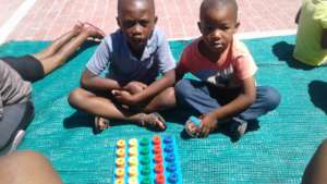 Fikile and his friend at a playgroup session