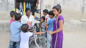 The child shopping at Rohan's Wheel Shop