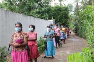 Families queuing for parcels