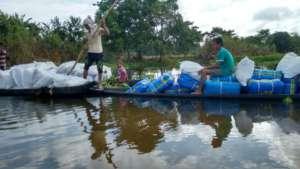 GOONJ team delivering relief kits