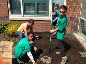 Comcast Cares garden workday