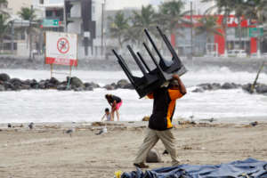 A man prepares for Hurricane Katia