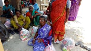 Destitute elders receiving food groceries