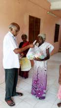 Lonely elder receives food groceries