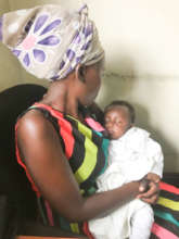 Immaculate with her HIV-negative baby