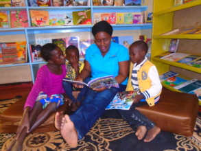 Kalaba reading a story for young library users