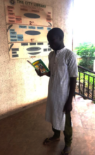 Muazu reading for fellow Almajiris
