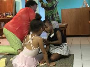 Primary (preK-K) students teach parents Montessori