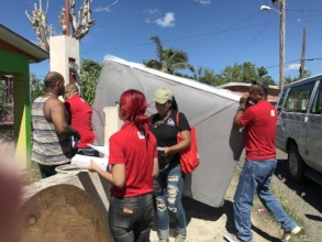 Volunteers dispatch furniture to community members