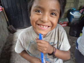 Young boy delighted with toothbrush gift.