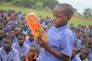 Primary student reads aloud on DEAR Day