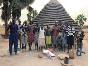 Villagers at well rehabilitation site