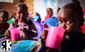 Children of Valley enjoying uji (porridge)